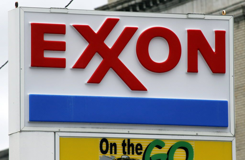 FILE - This April 29, 2014, file photo shows an Exxon sign at a mini-mart in Dormont, Pa.  Exxon Mobil Corp. is fighting against government investigators who believe the company covered up knowledge of how fossil fuels contribute to climate change. Exxon went to state court in Texas on Wednesday, April 13, 2016, to seek to quash a subpoena issued last month by the attorney general of the U.S. Virgin Islands. The company says the investigation violates its constitutional rights to speak freely and to be protected from unreasonable searches and seizures.(AP Photo/Gene J. Puskar, File)