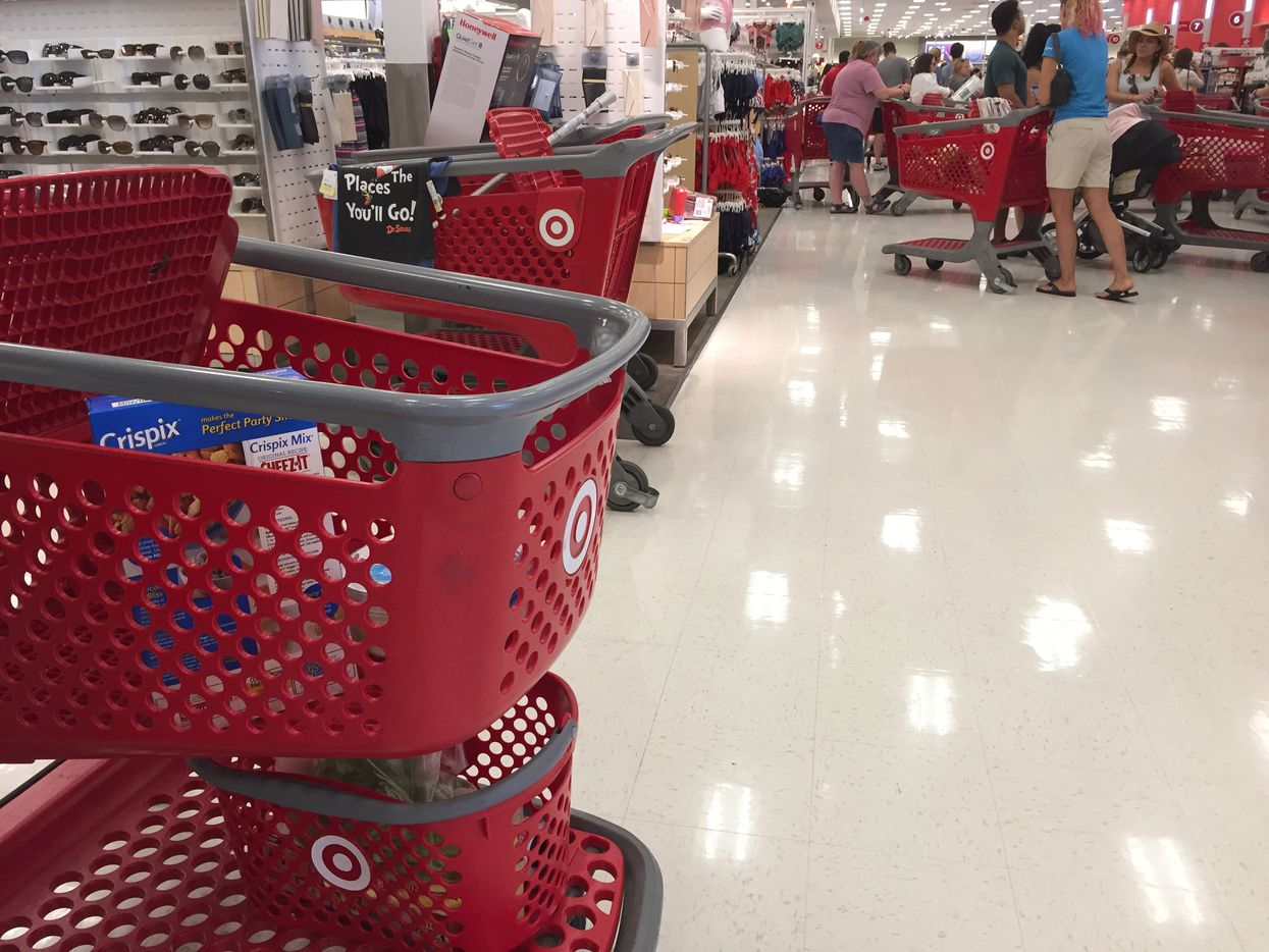 Customers left merchandise in carts around the checkout aisles at the Target off Larmanda and Skillman streets in Dallas on Saturday.