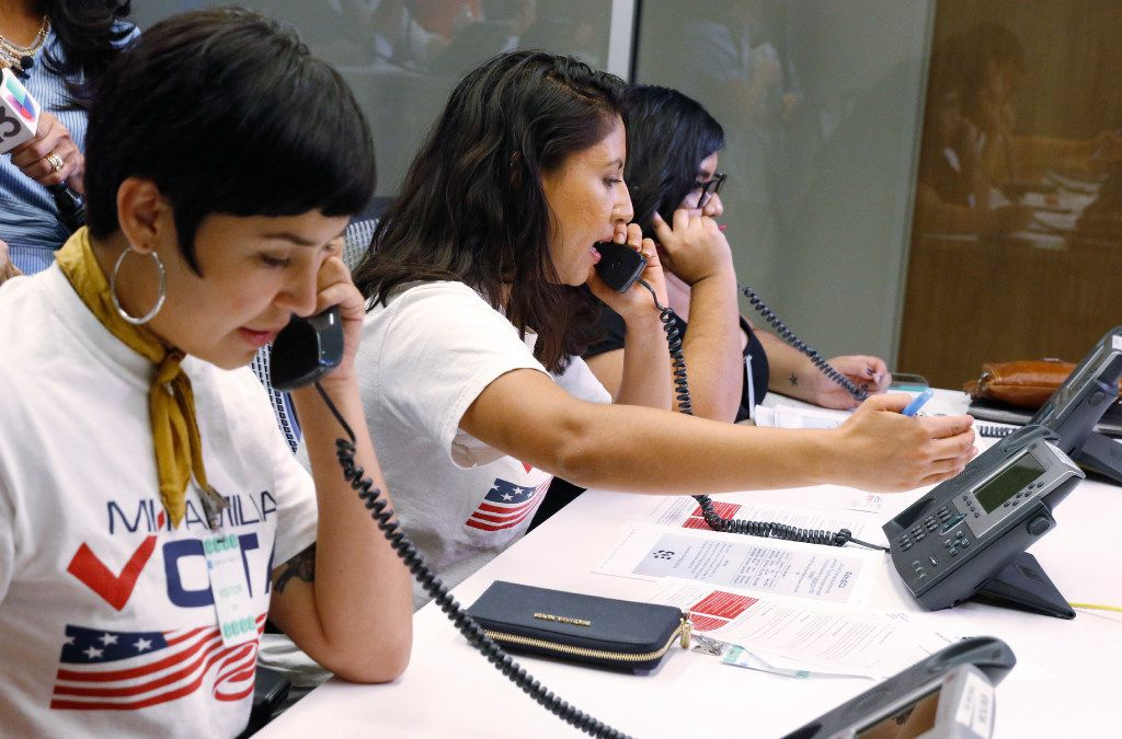 Linda Rivas, from left, Liz Magallanes, 23, center, DFW Coordinator for Mi Familia Vota, and Maria de Jesus Garza, answer phone calls about the DACA program at Univision TV studios in Dallas on Monday. President Trump is expected to announce Tuesday that the DACA program will end in 6 months.