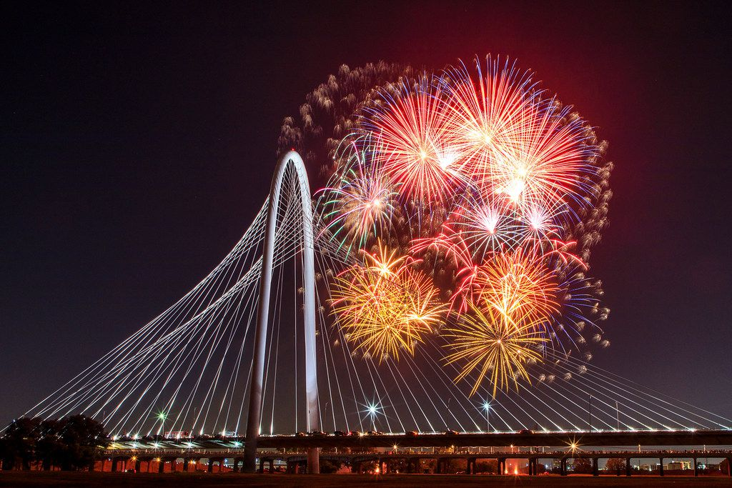Fireworks explode over the Margaret Hunt Hill Bridge during the Red, White, and Boom on the Bridge event on Tuesday, July 3, 2018, in Dallas. (Smiley N. Pool/The Dallas Morning News)