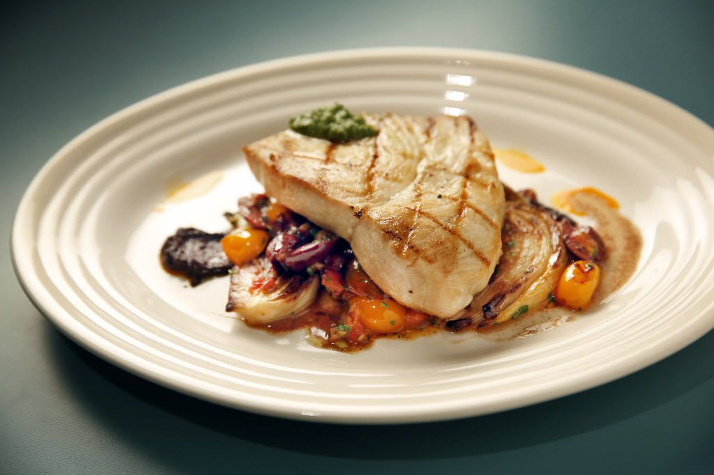 Grilled swordfish with roasted fennel, blistered tomatoes and olives