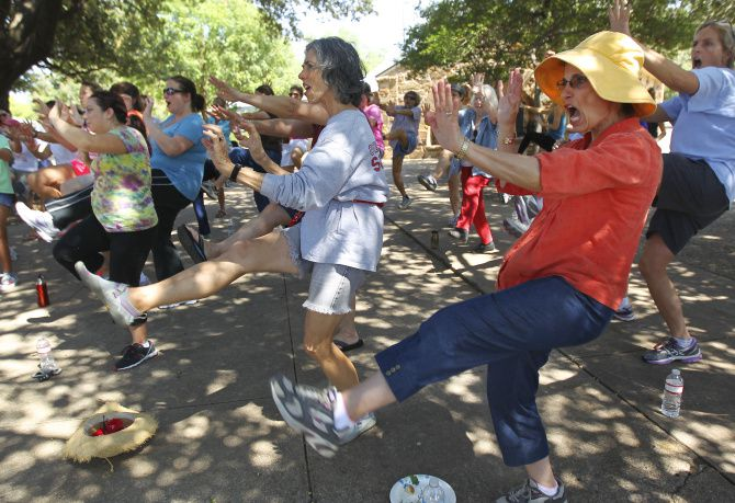 """About 65 women gathered Saturday in Tietze Park to learn self-defense techniques. """"It's like we're taking the power back,"""" one participant said. """"As women, we need that."""""""