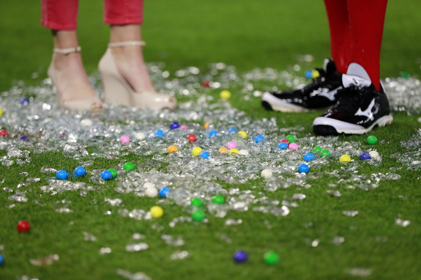 FOX Sports Southwest reporter Emily Jones and Texas Rangers left fielder Ian Desmond stood among the ice cubes and gumballs after Desmond was doused with cooler full of sport drinks following their 7-5 win at the Globe Life Park in Arlington on April 19, 2016.