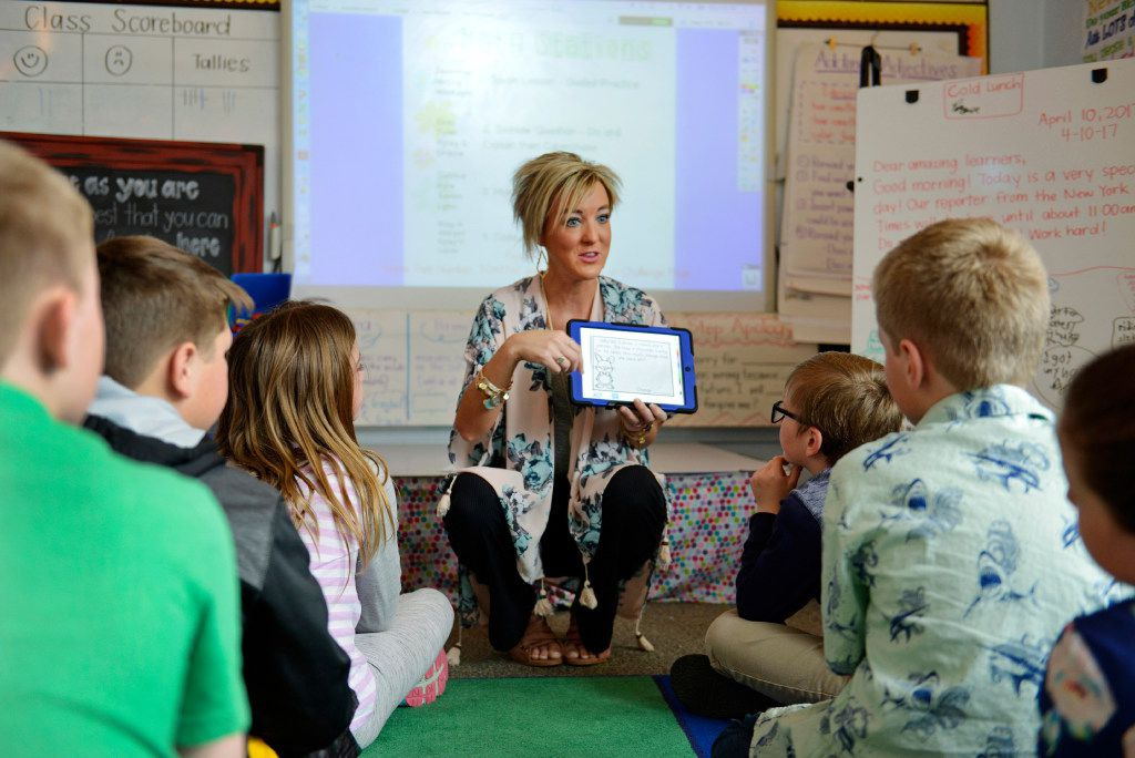 Third-grade teacher Kayla Delzer explains a math exercise on the program Seesaw to her students at Mapleton Elementary School in Mapleton, N.D. Many tech companies are competing to get their apps and products into classrooms. (Dan Koeck/The New York Times)