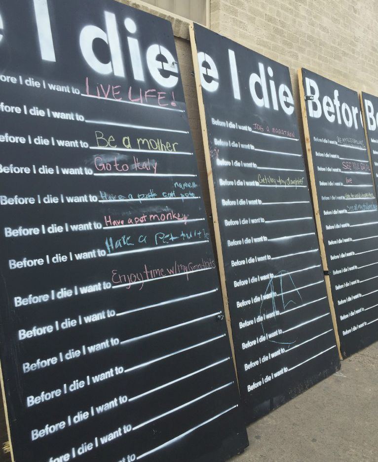 """Before I Die…""  is an interactive global art project that ""invites people of all ages to share their personal Bucket List aspirations"" in a public space.  (Julie Fancher/Staff writer)"
