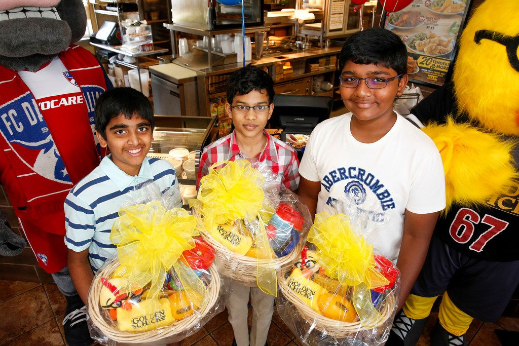 From left: Spelling bee co-champions Abhijay Kodali of Flower Mound, Sohum Sukhatankar of Dallas and Rohan Raja of Irving won a bounty of chicken tenders at an event in Dallas.