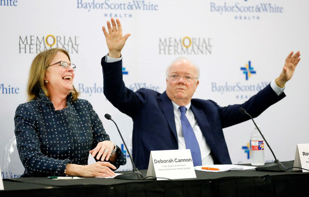 Deborah Cannon, Chair of Memorial Hermann Health System Board of Directors (left) laughs at Ross McKnight, Chair of Baylor Scott and White Holdings Board of Trustees who jokingly reminded her to not forget the hospital in his hometown of Throckmorton, Texas during a news conference at Baylor Charles A. Sammons Cancer Center in Dallas.  The press conference was held to announce the intended merger of Baylor Scott and White with Memorial Hermann Health System, October 1, 2018. The boards of both non-profit hospitals have signed a letter of intent to merge into a combined system. (Tom Fox/The Dallas Morning News)