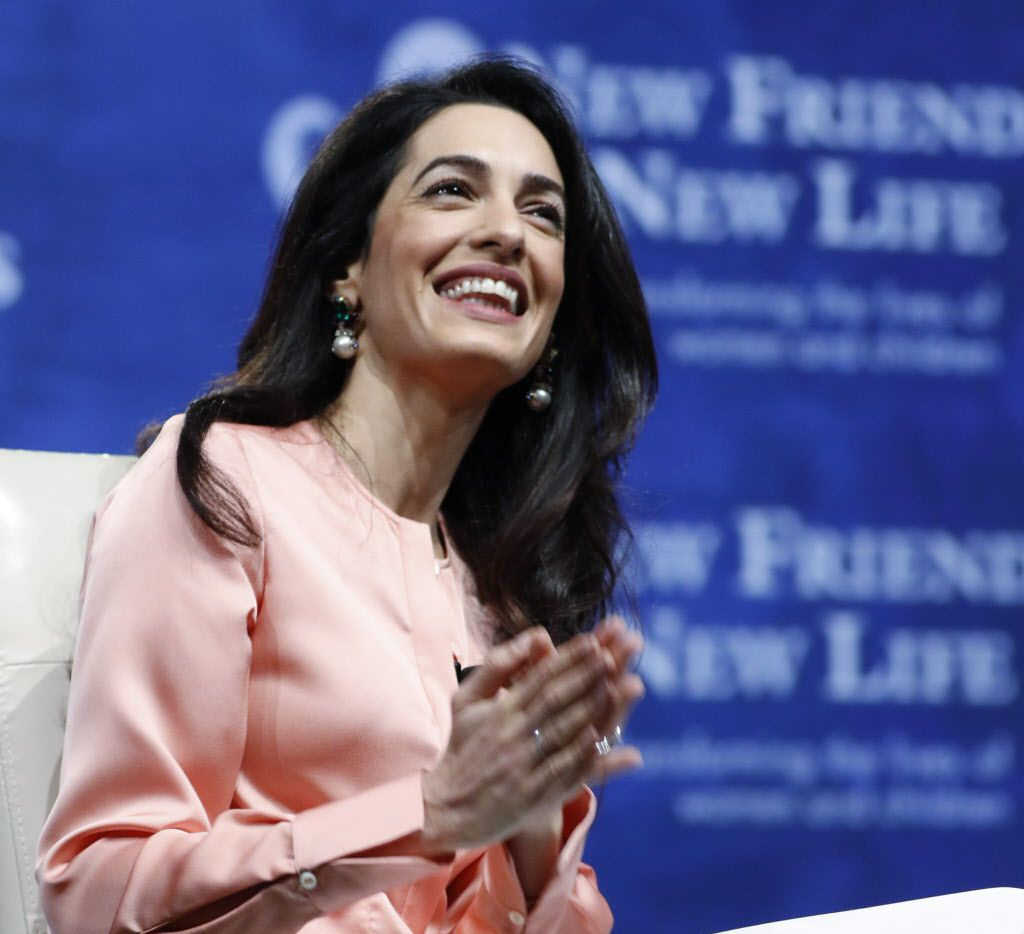 Amal Clooney responds to questions from WFAA Anchor, Shelly Slater about anti-trafficking and protecting women from sexual violence at New Friends New Life annual luncheon at Hilton Anatole in Dallas on Thursday, April 14, 2016.
