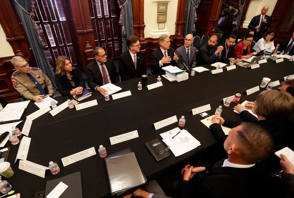 Gov. Greg Abbott (top center) makes opening statements during a round-table discussion at the state Capitol on Thursday with officials from Google, Twitter and Facebook as well as officials from the FBI and state lawmakers in the aftermath of the mass shooting in El Paso that reportedly targeted Mexicans.