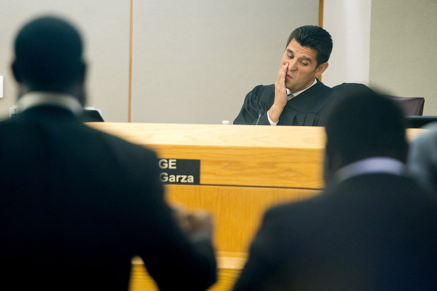 Judge Hector Garza held defense attorney Andrew Wilkerson (left) in contempt in his Dallas courtroom Thursday.