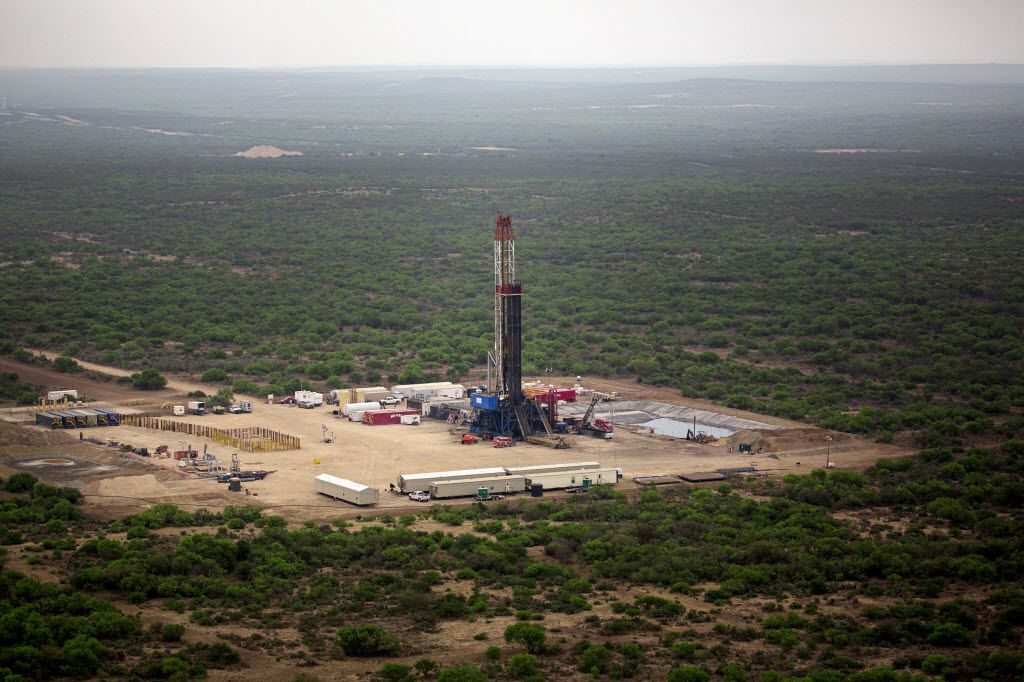 A natural gas drilling site stands in the middle of Webb County in this aerial image from 2014.