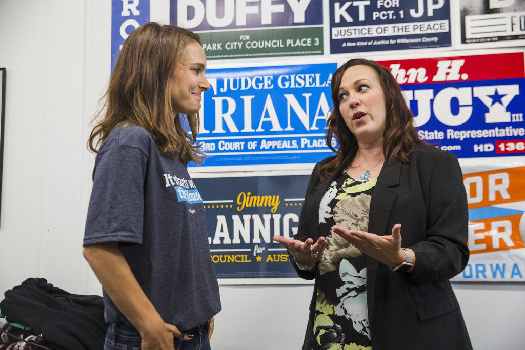 Actress Natalie Portman, left, stops by the office of MJ Hegar, then running for U.S. House, on Oct. 25, 2018, in Cedar Park, Texas.