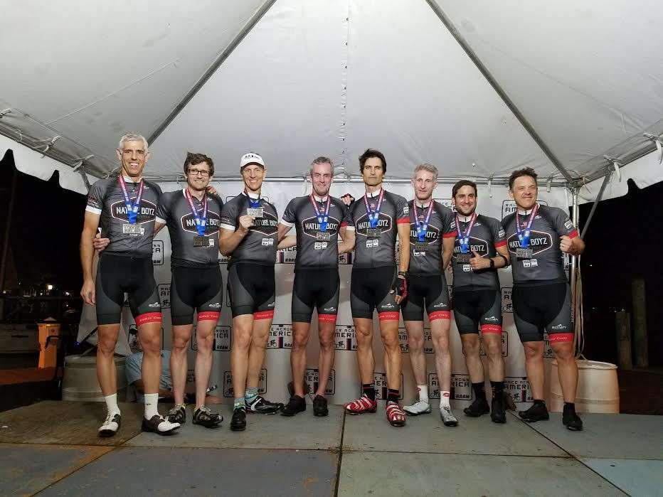 Craig Miller, far left, and his teammates pose for a photo after completing the 3,070-mile Race Across America relay