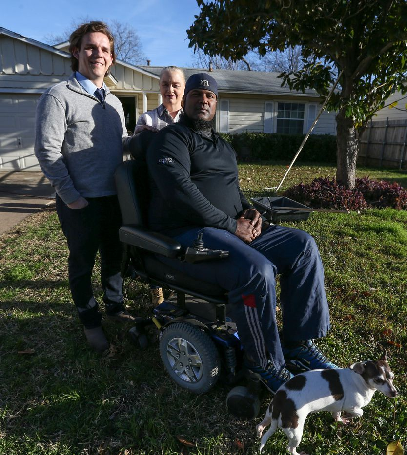 Will Toler (left) poses for a photograph with Vicki and Mark Booker at the Bookers' Hamilton Park home on Jan. 8, 2019, in Dallas.
