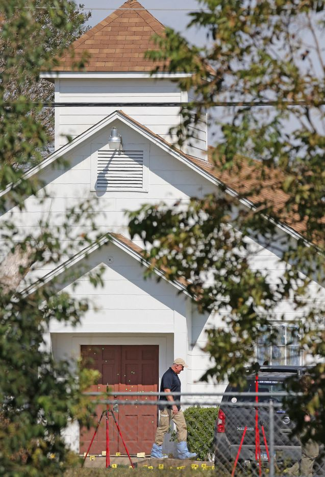 The front door of the First Baptist Church in Sutherland Springs shows multiple markings for bullet holes as officials continue to investigate Sunday's shooting where 26 people died after a gunman opened fire at a Baptist church in the small town southeast of San Antonio. Photographed in Sutherland Springs on Tuesday, November 7, 2017.