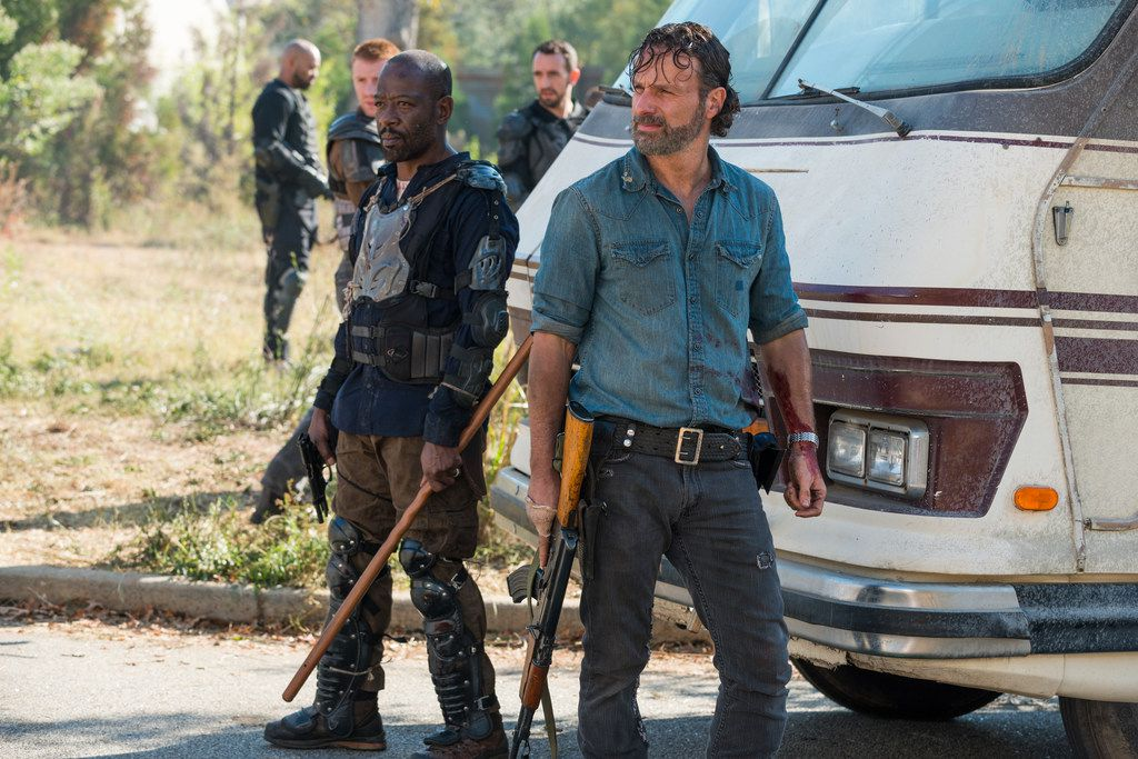 In this image released by AMC, Lennie James portrays Morgan Jones, left, and Andrew Lincoln portrays Rick Grimes in a scene from The Walking Dead. The eighth season premieres Oct. 22. (Gene Page/AMC via AP)