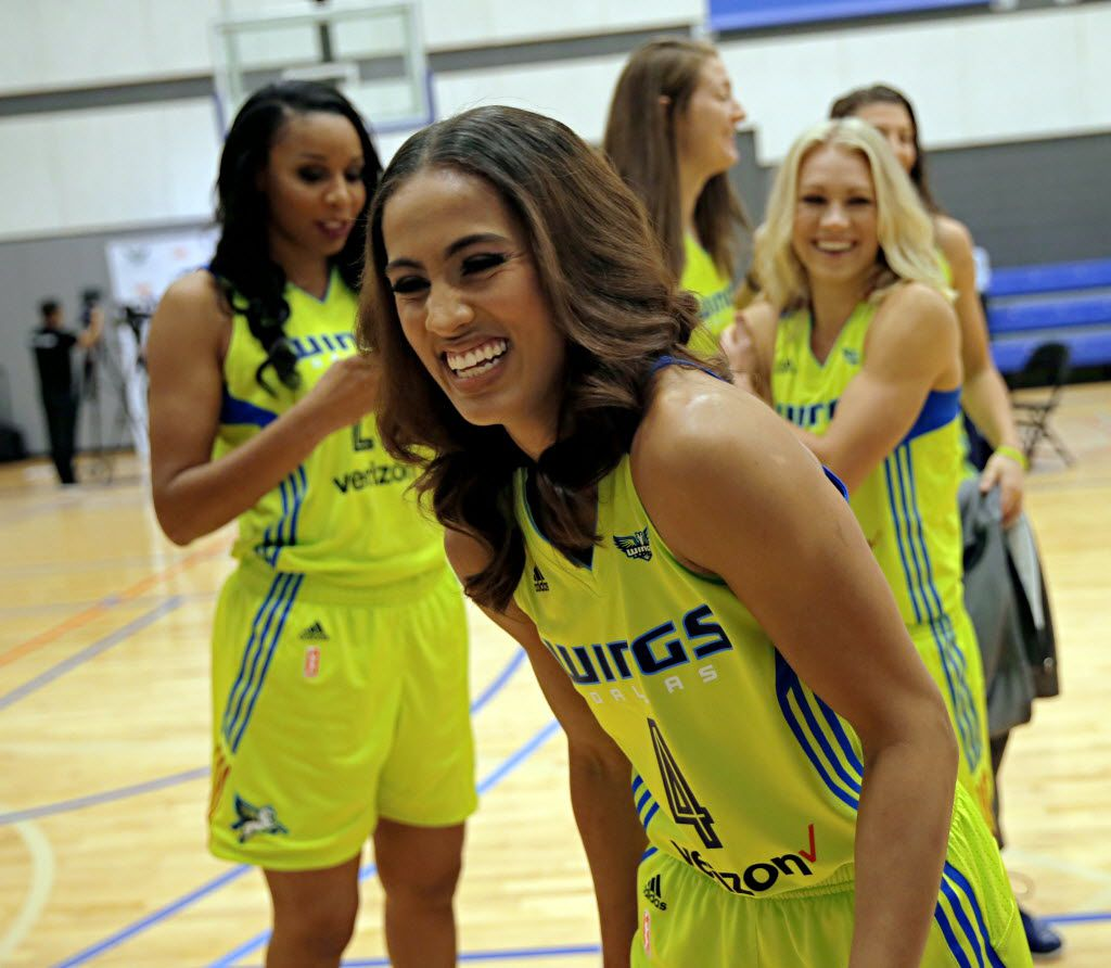 Dallas Wings guard Skylar Diggins (center) laughs after taking a selfie with teammates during a media day for the new WNBA team Monday, May 5, 2016 in Arlington, Texas. (G.J. McCarthy/The Dallas Morning News)