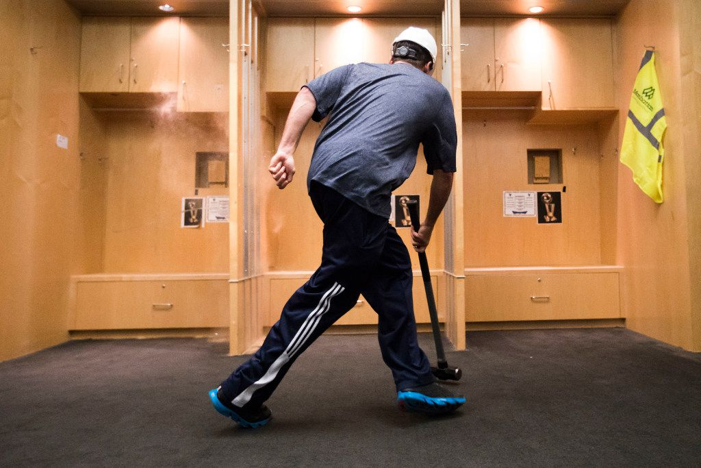 Dallas Mavericks owner Mark Cuban stumbles backwards as dust rises from the impact from his first hit of a sledgehammer to lockers to begin the demolition process of the Mavericks locker room during a press availability before the 2017 NBA Draft at American Airlines Center on Thursday,June 22, 2017, in Dallas. The team is renovating the locker room into a state-of-the-art facility for the start of next season. (Smiley N. Pool/The Dallas Morning News)