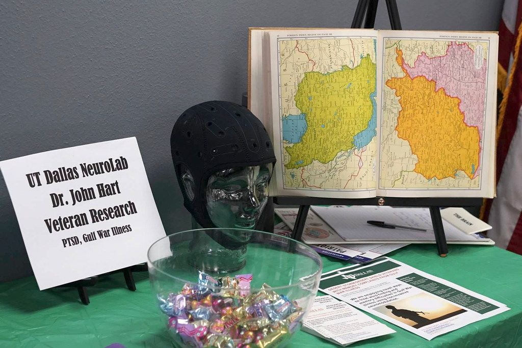 In March 2019, Dr. John Hart's lab members set up their table at a Career & Resource Workshop & BBQ at Farmers Branch. The event held was at 22KILL, a nonprofit organization focused on improving the mental health of veterans. The cap on the model head is similar to the device that the researchers use to measure brain activity.