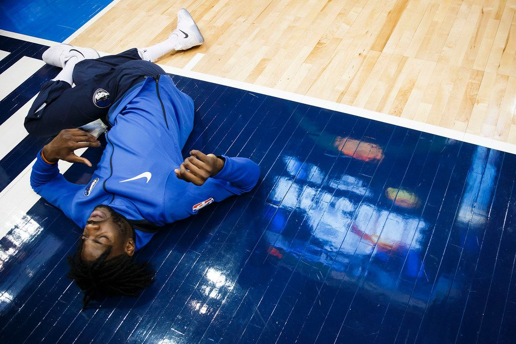 Nerlens Noel, shown here stretching before the Brooklyn game, will be out for at least a month after surgery Friday on his left thumb. (Smiley N. Pool/The Dallas Morning News/TNS)