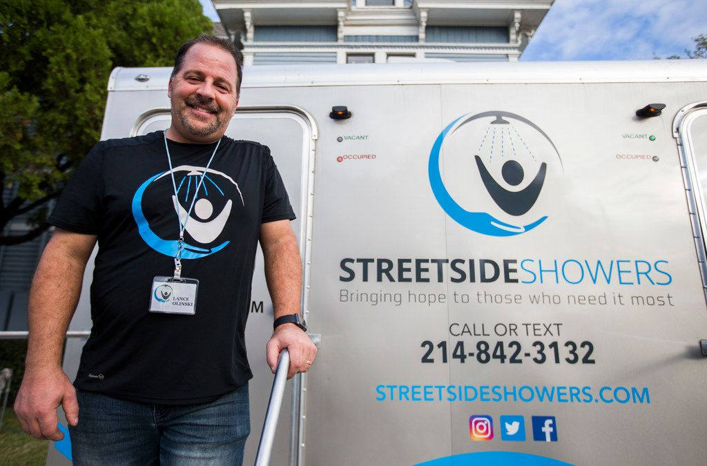 Lance Olinski of Streetside Showers poses for a photo next to his mobile showers parked outside City House on Tuesday, November 14, 2017 in Plano. Streetside Showers offers free showers to homeless people at various locations in Collin County. (Ashley Landis/The Dallas Morning News)