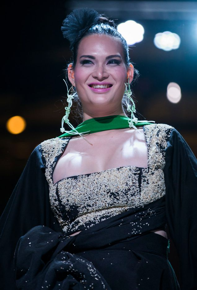 Model Alex Kongkeo smiles as she walks down the runway wearing an original dress by Audrie Austin during the Greater Dallas Restaurant Association's Food in Fashion event on Wednesday, Feb. 7, 2018, at Trinity Groves in Dallas. The dress was covered in sesame seeds and her earrings were made of noodles from Asian Mint.