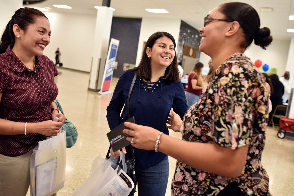Yelitza Duran (left) and Angela Molina (center)  of Seagoville thank Brenita Jackson, a Richland College enrollment representative, after she helped Angela during the Dallas County Community College District EduCareer Expo at Fair Park in Dallas on June 27, 2019.