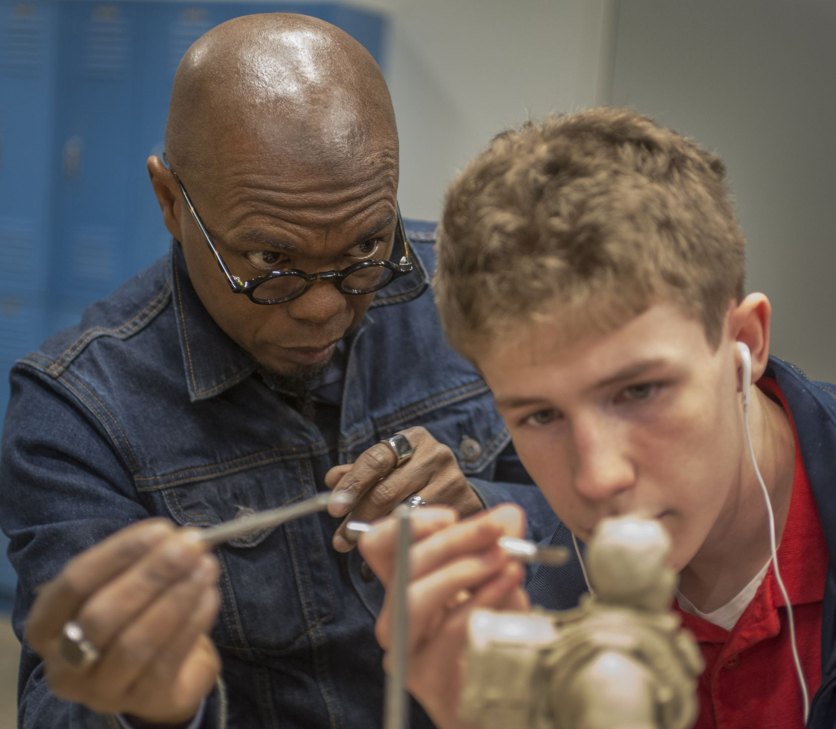 Sculptor Emmanuel Gillespie in the studio at The Winston School with student Chris Bird on a sculpture on January 16, 2019 in Dallas, Texas.