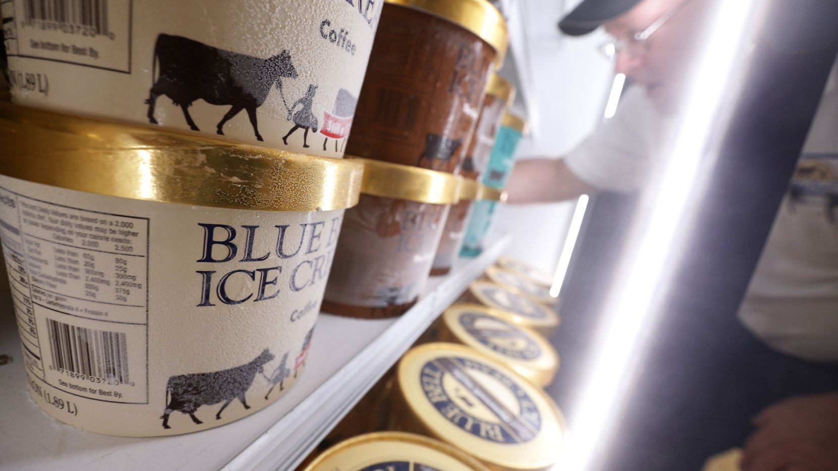 Robert Horton, route supervisor for Blue Bell Ice Cream, fills the refrigerated ice cream display at Tom Thumb in Dallas in 2016.
