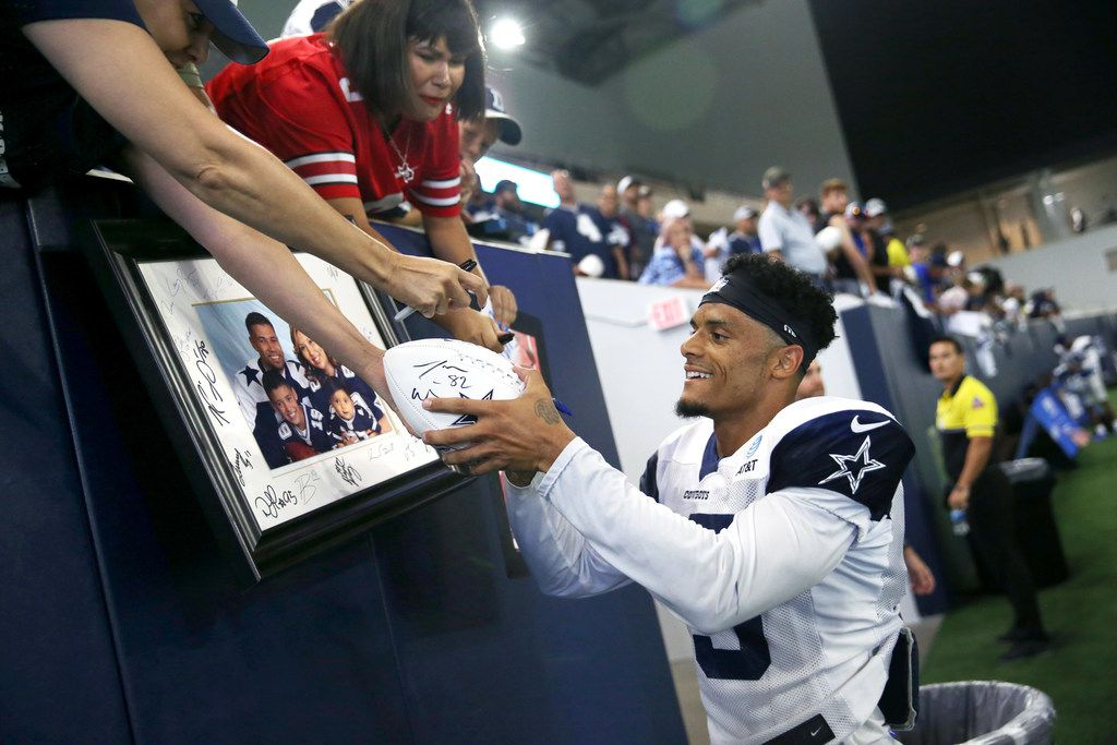 Dallas Cowboys wide receiver Devin Smith (15) signs autographs for fans during Dallas Cowboys training camp in the Ford Center at The Star in Frisco, Texas on Tuesday, Aug. 20, 2018. (Lynda M. Gonzalez/The Dallas Morning News)