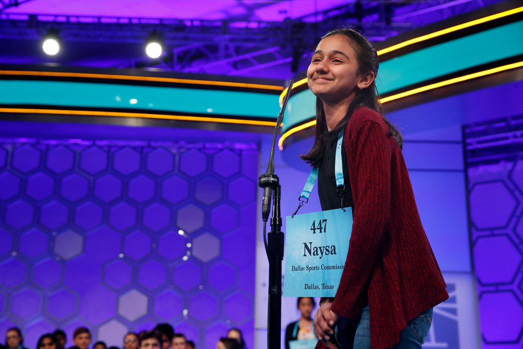 Naysa Modi, 12, of Frisco smiled after spelling her word correctly during the second Round of the Scripps National Spelling Bee on Tuesday in Oxon Hill, Md.