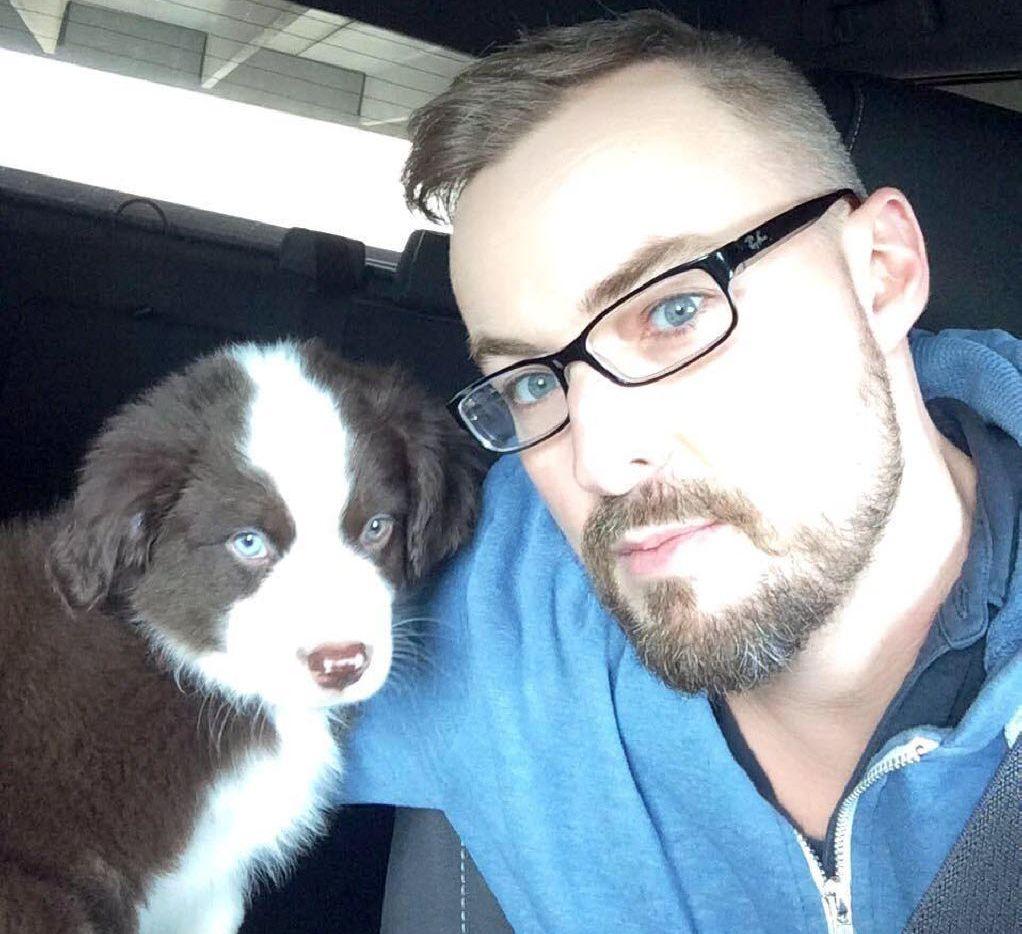 Thyren Justus with his puppy, Luke.