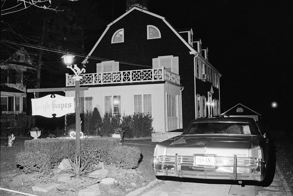 On Nov. 14, 1974, police and members of the Suffolk County Coroner's Office investigate the murder of six people found shot in Amityville, N.Y. The house made famous in the 1979 film 'The Amityville Horror.' The house is featured in episode three of 'Strange' in a collaboration with Atlas Obscura.  (AP Photo/Richard Drew, File
