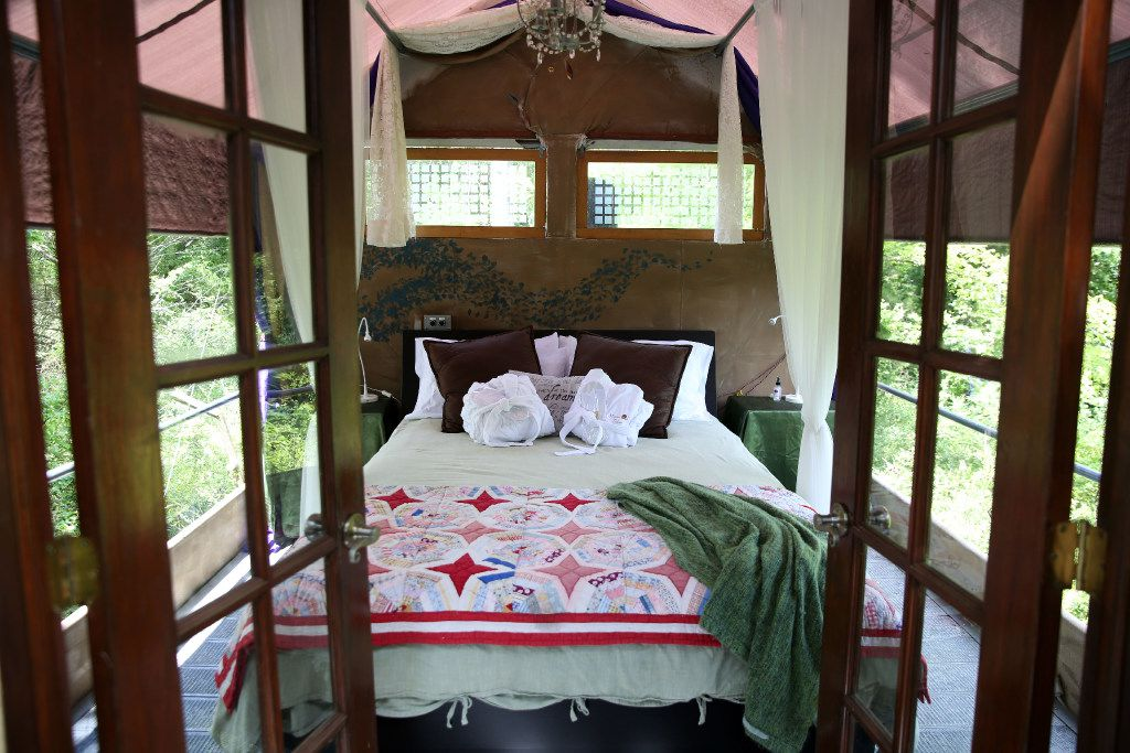 The open-air bedroom in the Majestic Oak Treehouse at Savannah's Meadow in Celeste.