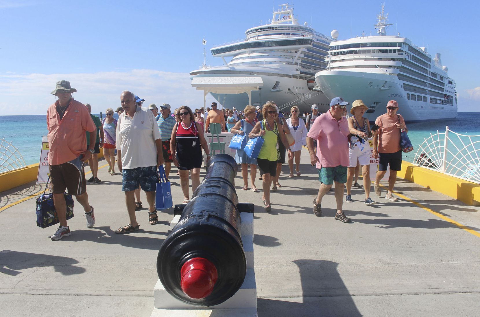 Passengers disembark from Princess Cruises' Crown Princess, left, and Silversea's Silver Muse at Grand Turk Island, in the Turks and Caicos. The cruise industry has exploded, offering a much bigger range of itineraries and options for almost every traveler's taste.
