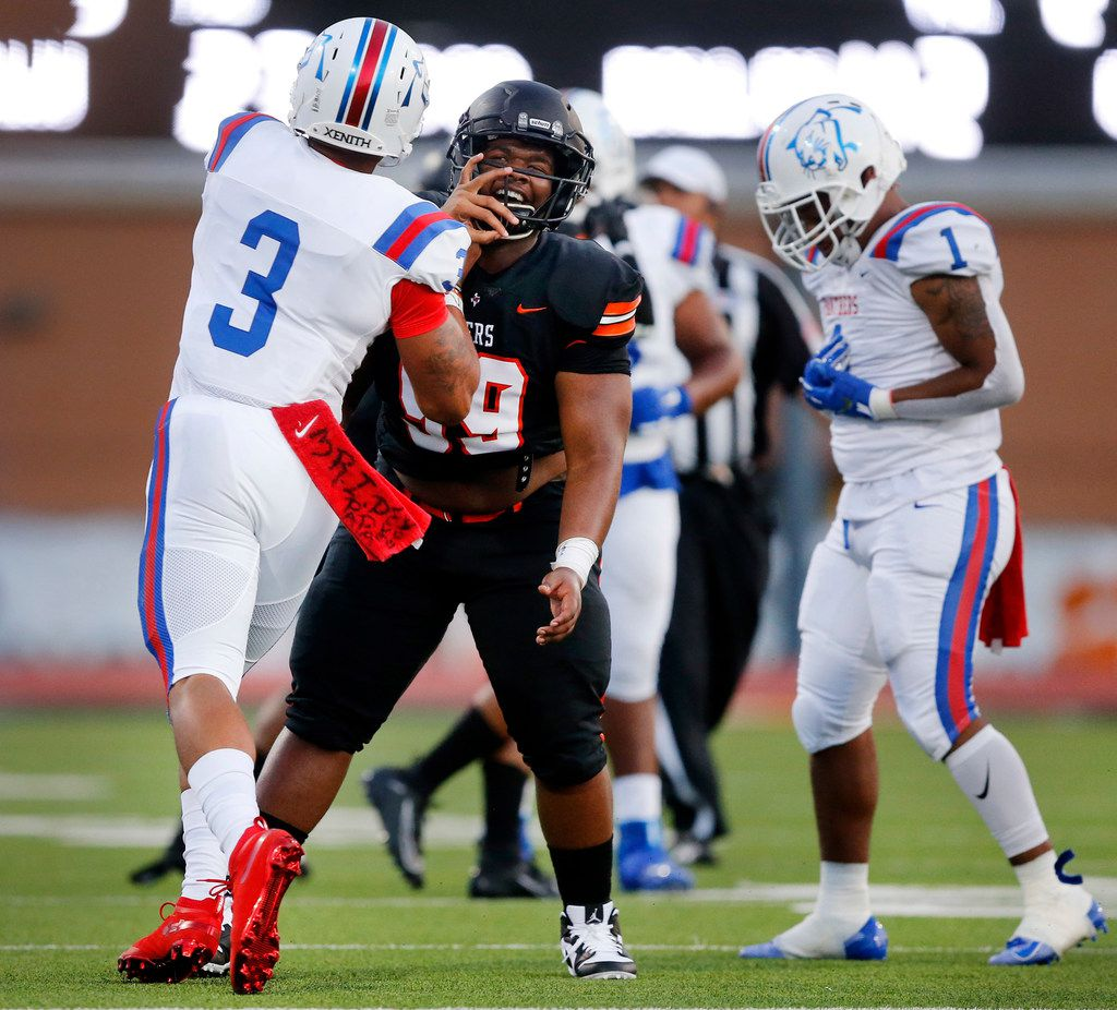 Duncanville quarterback Ja'Quinden Jackson (3) shoves Lancaster defensive lineman Dayven Monroe (99) after throwing a first quarter interception at Beverly D. Humphrey Tiger Stadium in Lancaster Texas, Friday, August 30, 2019. (Tom Fox/The Dallas Morning News)