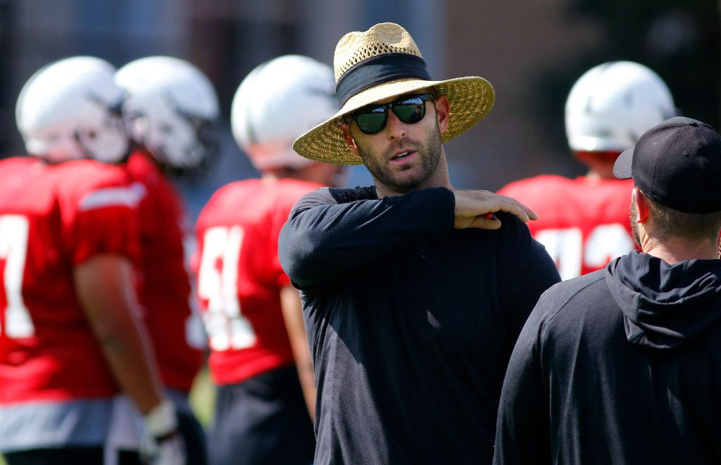 Texas Tech head football coach Kliff Kingsbury  visits with his staff during an afternoon practice on campus in Lubbock, Texas, Wednesday, August 2, 2017. (Tom Fox/The Dallas Morning News)