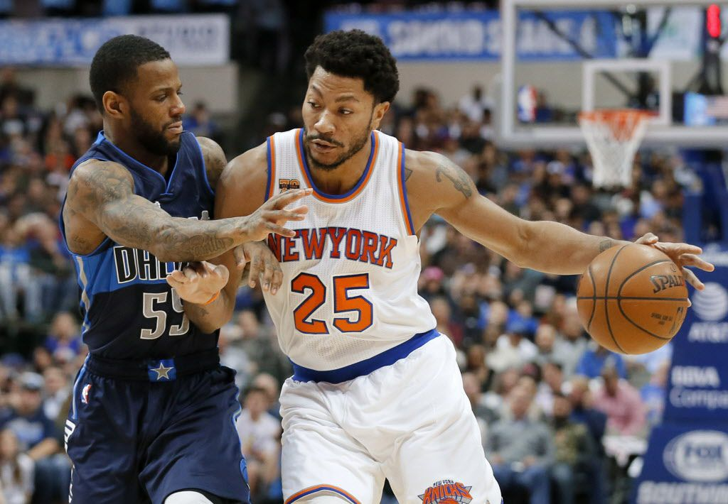 Dallas Mavericks' Pierre Jackson (55) defends as New York Knicks guard Derrick Rose (25) moves the ball up court in the first half of an NBA basketball game, Wednesday, Jan. 25, 2017, in Dallas. (AP Photo/Tony Gutierrez)