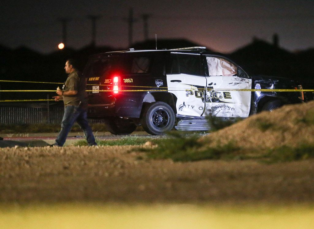 Police are seen Saturday, Aug. 31, 2019 at a Cinergy movie theatre in Odessa, Texas. At least five people died after more than 20 people were shot Saturday when a gunman hijacked a postal truck and began shooting randomly in the Odessa area of West Texas, authorities say.(Ryan Michalesko/The Dallas Morning News)