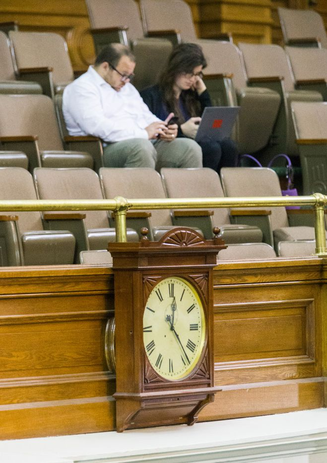 A clock posted in the Senate Chambers reads 12:24 a.m. as the senate meets for a third reading of the Sunset Bill during the third day of a special legislative session on Thursday at the Texas Capitol in Austin.