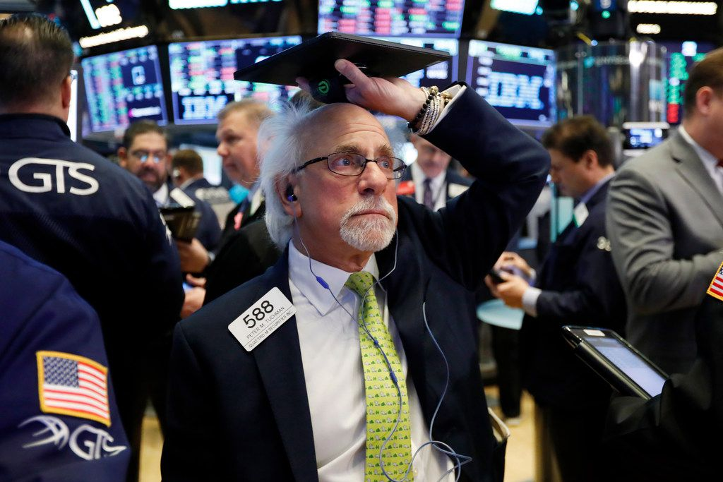 Trader Peter Tuchman works on the floor of the New York Stock Exchange.