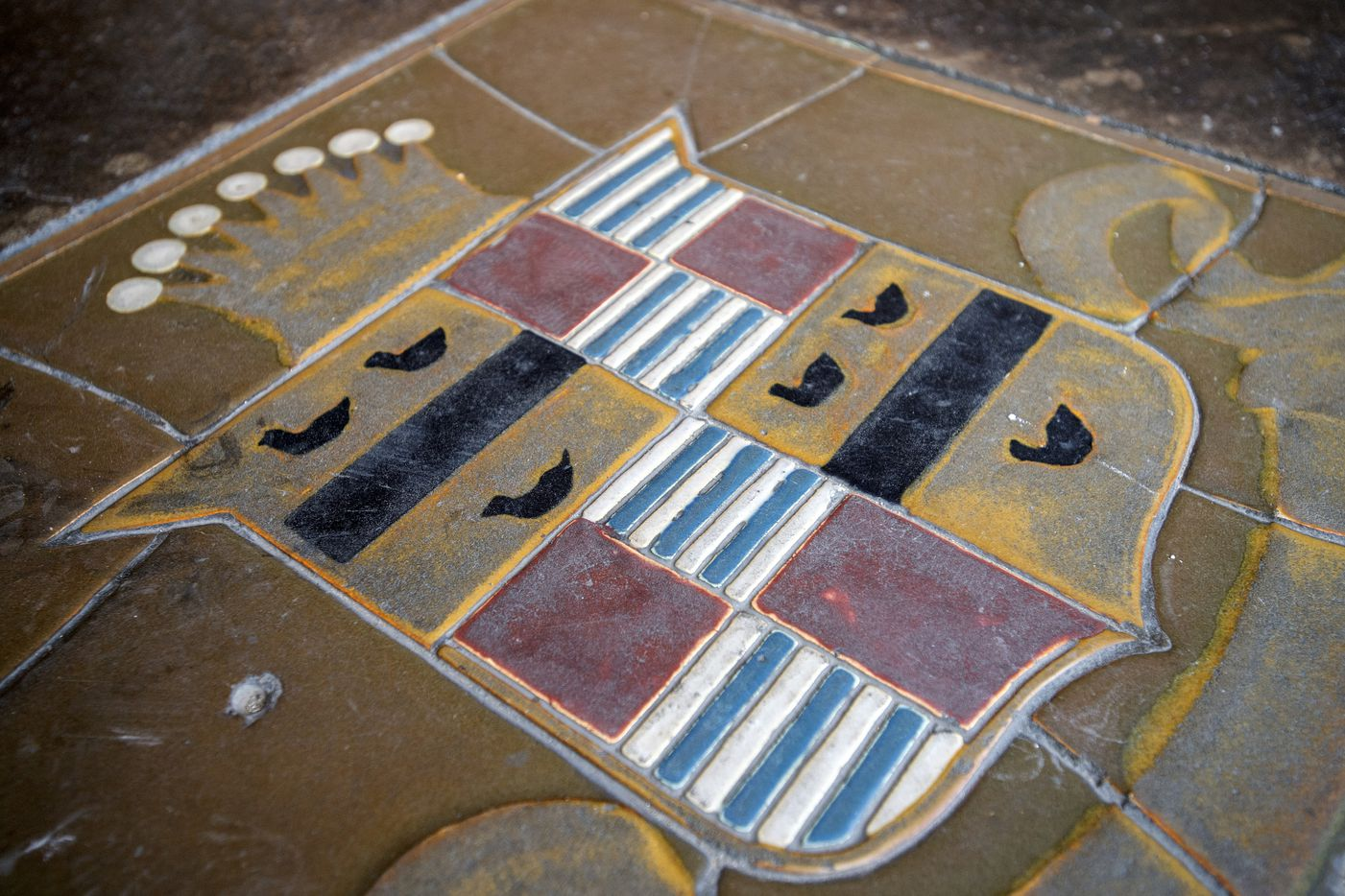 The Cadillac emblem is etched into the floor of the former showroom on Commerce Street.