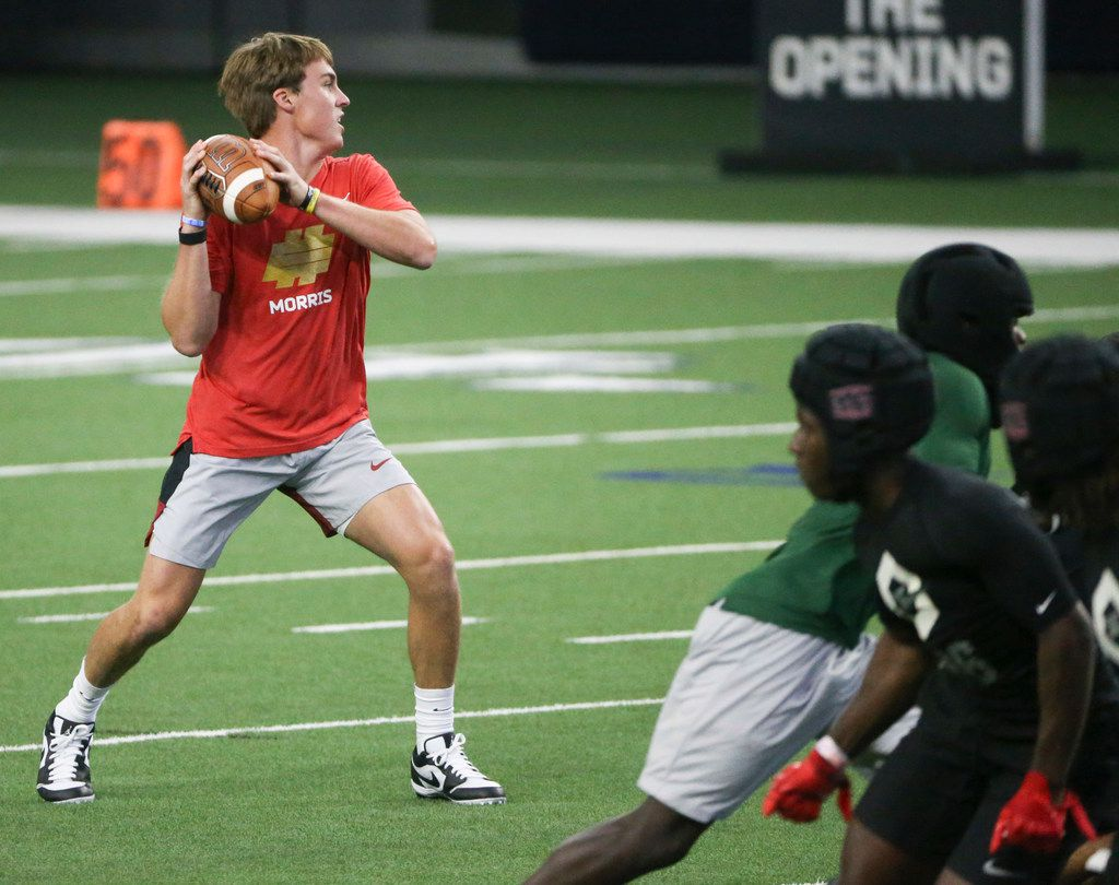 Quarterback Chandler Morris, of Highland Park, Texas, looks to make a pass during the Elite 11 competition at The Star on Sunday, June 30, 2019. The Elite 11 is part of The Opening, an elite training camp and a 7on7 football competition.(Shaban Athuman/Staff Photographer)