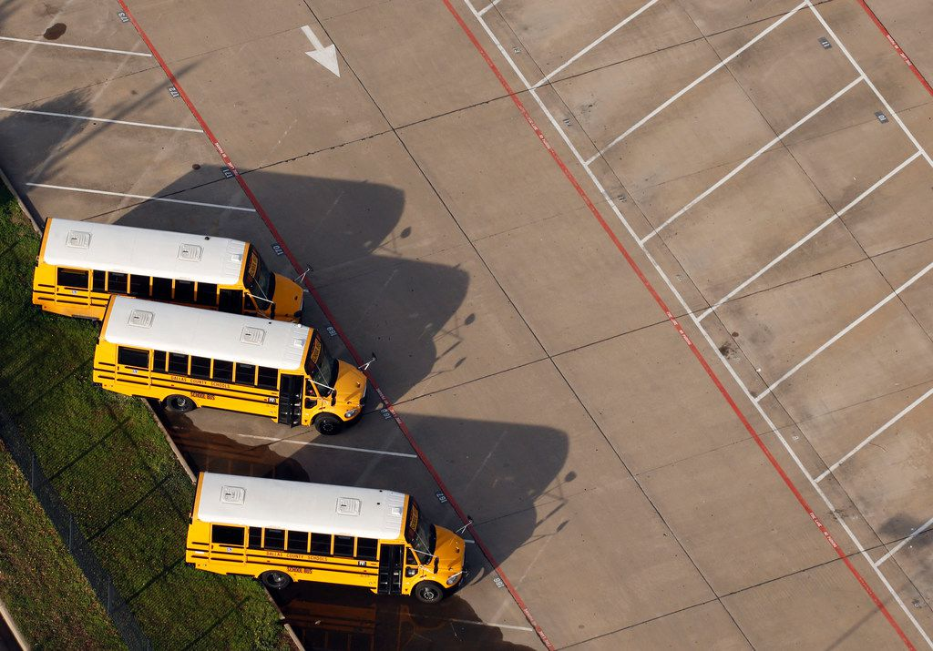 Dallas County School buses in a parking lot in Dallas on Thursday, March 1, 2018. (Vernon Bryant/The Dallas Morning News)