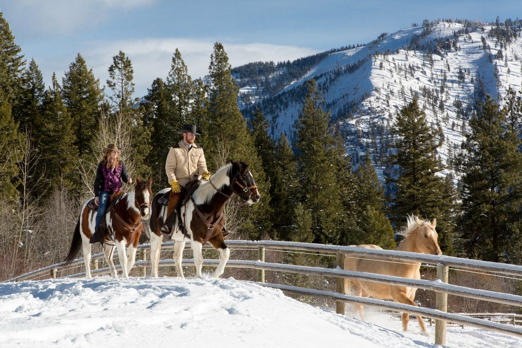 Hitting the trail on horseback is a great way to see the winter scenery at Montana's Triple Creek Ranch.
