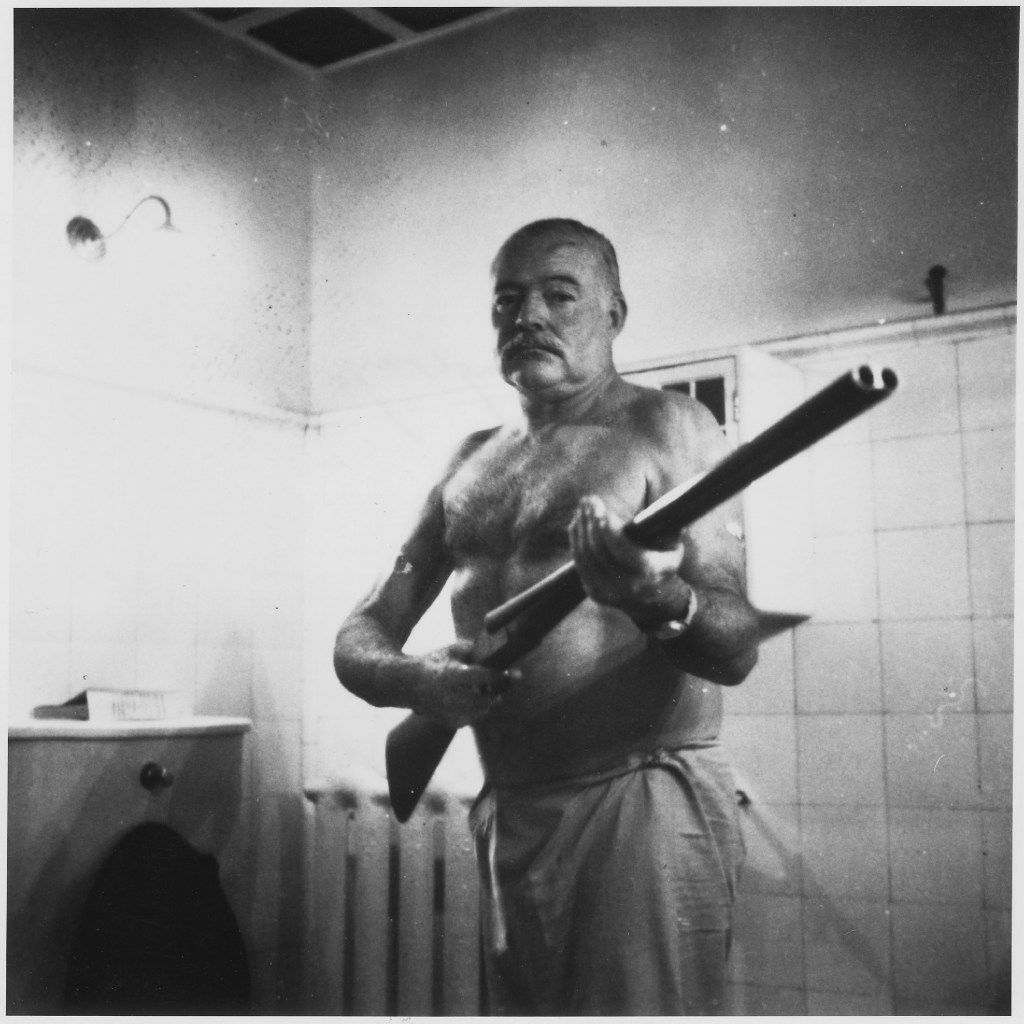 Ernest Hemingway on guard at Finca Vigia, his home outside Havana. The Cuban Revolution led him to fear looters and kidnapping. From Writer, Sailor, Soldier, Spy,  by Nicholas Reynolds.
