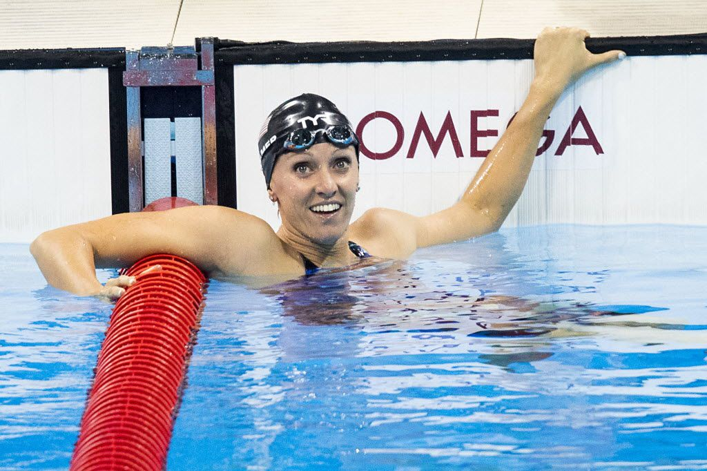 Dana Vollmer of the United States looks back for her time after swimming to a bronze medal in the women's 100m butterfly finals at the Rio 2016 Olympic Games on Sunday, Aug. 7, 2016, in Rio de Janeiro. (Smiley N. Pool/The Dallas Morning News)