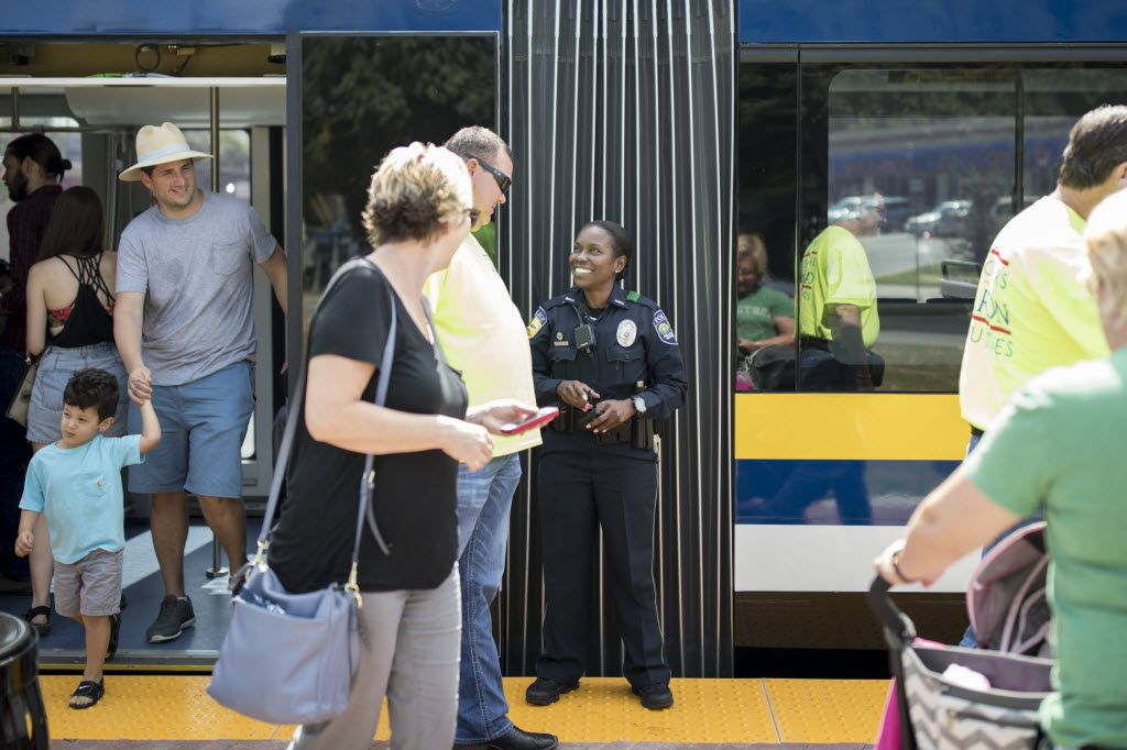 DART police Officer Bridget Broadneax greeted riders Saturday at the newly built Bishop Arts District streetcar stop.