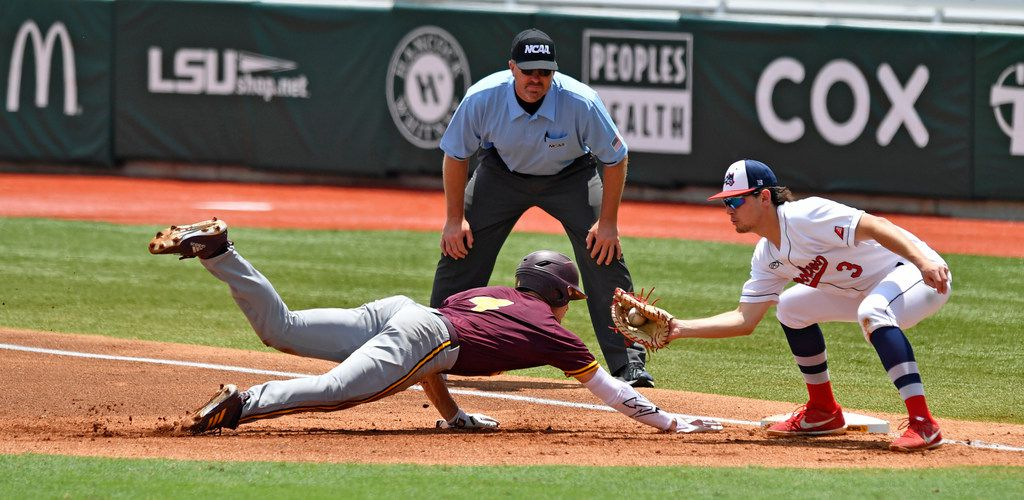 Arizona State's Hunter Bishop (4) is safe on a pickoff-attempt as Stony Brook first baseman Chris Hamilton (3) is late to apply the tag in the first inning of Game 3 of an NCAA college baseball regional tournament Saturday, June 1, 2019, in Baton Rouge, La. (Hilary Scheinuk/The Advocate via AP)