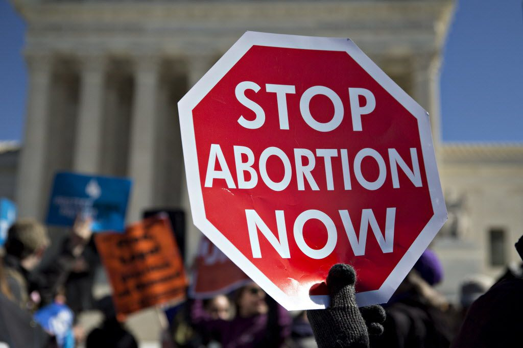 Abortion-rights foes rallied outside the Supreme Court during arguments in a significant Texas case March 2. Did lawyers for the clinics miss a key piece of research in their preparation? (Bloomberg photo)